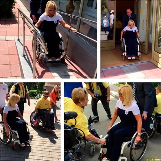 Оксана Пушкина в инвалидной коляске