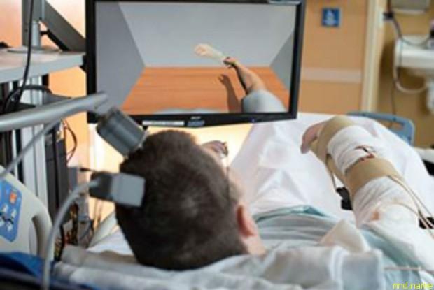 Парализованный смог двигать рукой с помощью нейроимплантата